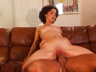 Curly woman riding and sucking
